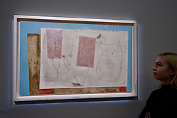 """© Licensed to London News Pictures. 17/11/2017. London, UK.  London, UK.  17 November 2017. A staff member views """"Sept 58 (Iseo)"""", 1958, by Ben Nicholson (Est. GBP 400-600k). Preview upcoming auctions of Modern & Post War British Art and Scottish Art taking place at Sotheby's, New Bond Street, on 21 and 22 November. Photo credit: Stephen Chung/LNP"""