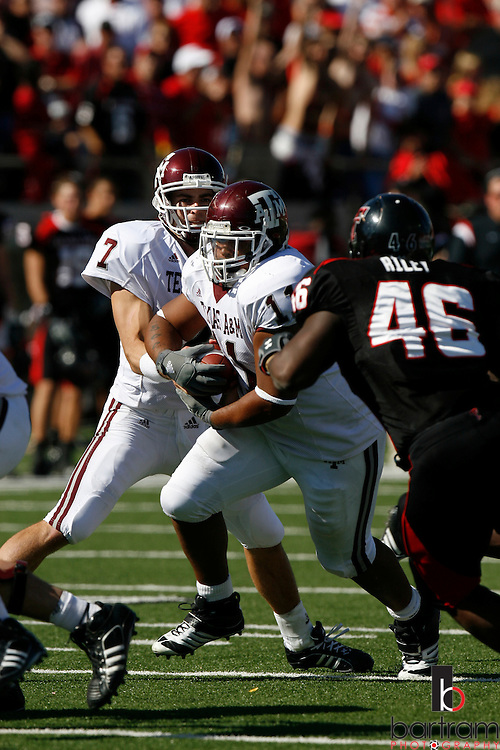 Texas A&M quarterback Stephen McGee hands the ball to fullback Jorvorskie Lane as Texas Tech linebacker Sandy Riley closes in on Saturday, Oct. 13, 2007 in Lubbock, Texas. Texas Tech won the game 35-7.