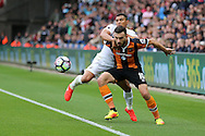 Robert Snodgrass of Hull city (l) holds off Jefferson Montero of Swansea city as the ball stays in play. Premier league match, Swansea city v Hull city at the Liberty Stadium in Swansea, South Wales on Saturday 20th August 2016.<br /> pic by Andrew Orchard, Andrew Orchard sports photography.