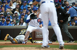April 14, 2017 - Chicago, IL, USA - The Chicago Cubs' Anthony Rizzo catches the throw from starting pitcher Kyle Hendricks in the sixth inning, chasing the Pittsburgh Pirates' Andrew McCutchen (22) back to first base at Wrigley Field in Chicago on Friday, April 14, 2017. The Pirates won, 4-2. (Credit Image: © John J. Kim/TNS via ZUMA Wire)