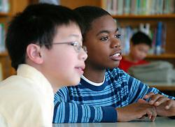 United States, Washington, Seattle, boys in middle school classroom