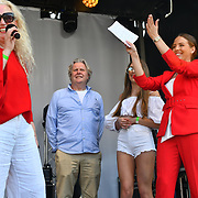 Basking in London - Jazz Mino performs Lydia Bright announce her mum & dad getting marriage at the Feast of St George to celebrate English culture with music and English food stalls in Trafalgar Square on 20 April 2019, London, UK.