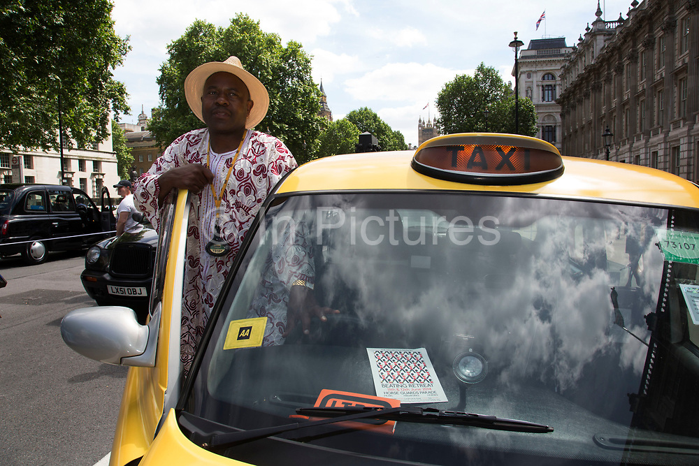 London, UK. Wednesday 11th June 2014. Black taxi drivers protest against taxi service app Uber, brings central London to a standstill. Joined in many numbers by future black cab drivers on mopeds currently doing 'The Knowledge'. London cabbies emphasised that they had no problem with Uber, only with Transport for London for not enforcing current legislation. Taxi drivers say the Uber app is tantamount to a meter and should be regulated like taxi meters. Uber says it has seen an 850% increase in sign-ups compared to last Wednesday and describes the London Taxi Drivers Association (LTDA), as being stuck in the dark ages.