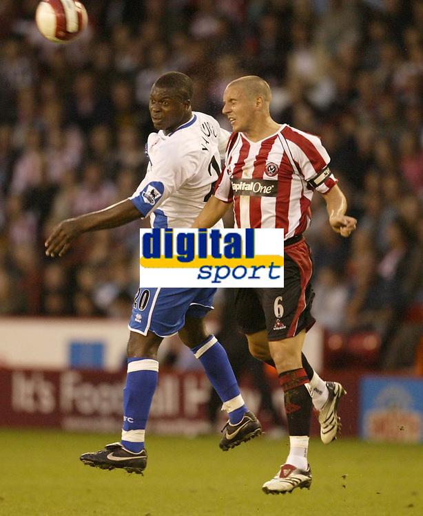 Photo: Aidan Ellis.<br /> Sheffield United v Middlesbrough. The Barclays Premiership. 30/09/2006.<br /> Sheffield's Phil jagielka and Boro's Yakubu