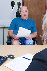 Disabled man being interviewed for a job with a potential employer,