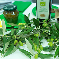 Olives and Olive oil are on display at one of the stands of the Biennale del Gusto on October 28, 2013 in Venice, Italy. The Biennale del Gusto is an exhibition held over four days, dedicated to traditional food and drinks from all regions of Italy.