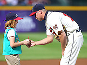 ATLANTA, GA - SEPTEMBER 29:  Third baseman Chipper Jones #10 of the Atlanta Braves signs a ball for a Girl Scout before the game against the New York Mets at Turner Field on September 29, 2012 in Atlanta, Georgia.  (Photo by Mike Zarrilli/Getty Images)