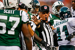 A Referee breaks up a play during the NFL game between the Philadelphia Eagles and the New York Jets on September 3rd 2009. The Jets won 38-27 at Giants Stadium in East Rutherford, NJ.  (Photo By Brian Garfinkel)