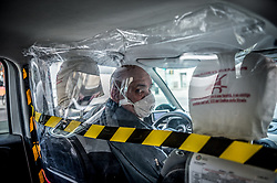 An anti virus protection on a taxi in Milan, Italy on April 18, 2020. Daily life scenes with the new anti-COVID-19 Coronavirus prevention measures. Photo by Carlo Cozzoli/IPA/ABACAPRESS.COM