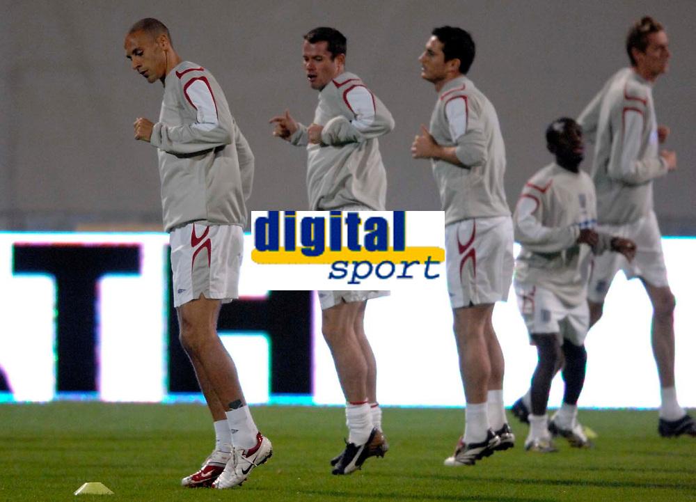 Photo: Richard Lane<br />England Training Session. 10/10/2006. <br />England's Rio Ferdinand (lt) warms up.