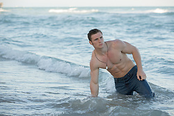 All American man enjoying time in the ocean