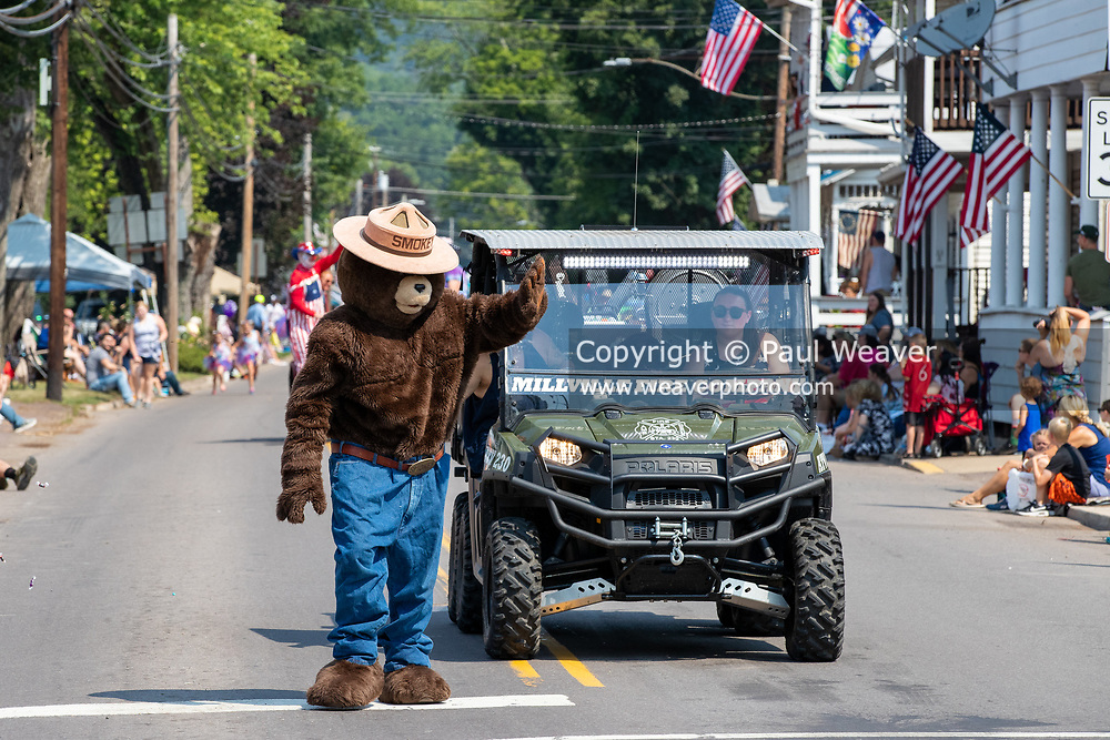 Smokey Bear waves to children watching the Independence Day parade in Millville, Pennsylvania on July 5, 2021.