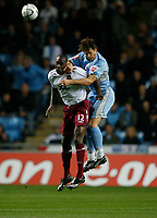 Photo: Steve Bond.<br />Coventry City v West Ham United. Carling Cup. 30/10/2007.Carlton Cole (L) is beaten in the air by Arjan de Zeeuw (R)