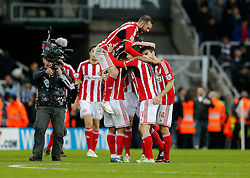 Winning goalscorer Adam Johnson is jumped on by Steven Fletcher as he celebrates with his teammates at full time after Sunderland win 0-1 with a late goal - Photo mandatory by-line: Rogan Thomson/JMP - 07966 386802 - 21/12/2014 - SPORT - FOOTBALL - Newcastle upon Tyne, England - St James' Park - Newcastle United v Sunderland - Tyne-Wear derby - Barclays Premier League.