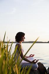 Jun. 17, 2009 - Woman Doing Yoga At Lakeside. Model Released (MR) (Credit Image: © Cultura/ZUMAPRESS.com)