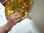 Local man doing handicrafts, decorating a plate in Kashmir, India