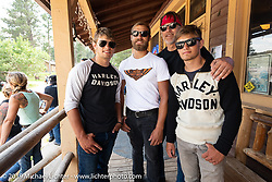 17-year old twins Luke Knight (left) and Matthew (right), older brother Lance in between and their Dad Timothy behind on the Sturgis Black Hills Motorcycle Rally. SD, USA. Wednesday, August 7, 2019. Photography ©2019 Michael Lichter.