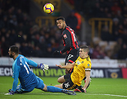 Bournemouth's Joshua King (centre) sees his shot saved by Wolverhampton Wanderers goalkeeper Rui Patricio