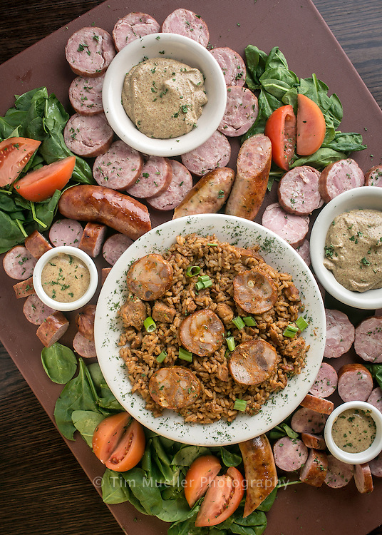 """St. John the Baptist Parish in south Louisiana holds its annual Andouille Festival each year in the fall. The festival promotes St. John the Baptist Parish as """"The Andouille Capital of the World."""" Andouille sausage is a smoked sausage made out of pork and garlic. The sausage is closely associated with Cajun food, where it plays a major role in dishes such as jambalaya."""