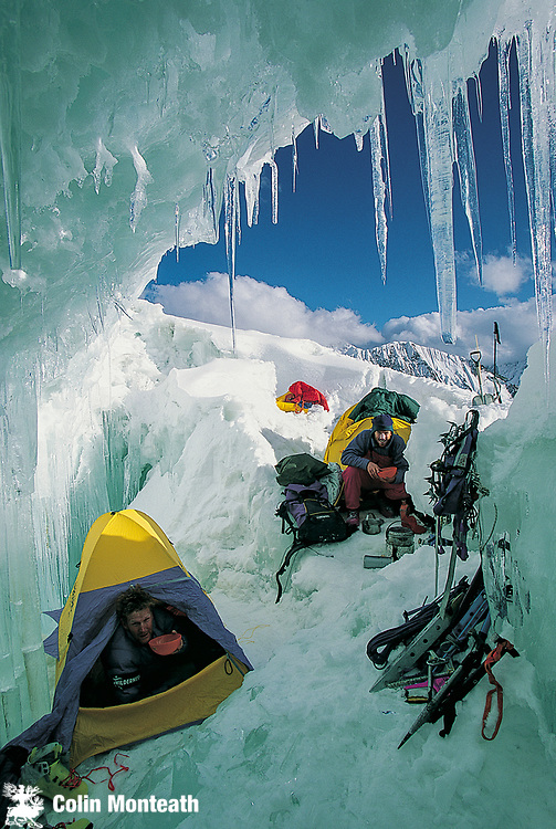 Climbers eat dinner  - tent camp in shelter of crevasse on 7300m peak 1st ascent Chongtar, Karakoram Mts, far western China, Central Asia