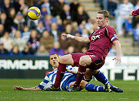 Photo: Gareth Davies.<br />Reading v Bolton Wanderers. The Barclays Premiership. 02/12/2006.<br />Reading's Steve Sidwell (bottom) up ends the Bolton captain Kevin Nolan (top).