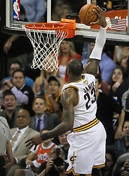 The Cleveland Cavaliers' LeBron James dunks the ball against the Golden State Warriors in the second quarter during Game 4 of the NBA Finals at Quicken Loans Arena in Cleveland on Friday, June 9, 2017. (Photo by Leah Klafczynski/Akron Beacon Journal/TNS) *** Please Use Credit from Credit Field ***