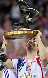 Nikola Karabatic (13) of France celebrates after the 21st Men's World Handball Championship 2009 Gold medal match between National teams of France and Croatia, on February 1, 2009, in Arena Zagreb, Zagreb, Croatia. France won 24:19 and became World Champion 2009.  (Photo by Vid Ponikvar / Sportida)