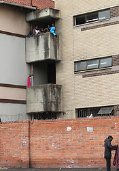 South Africa - Durban - 18 June 2020 - A kid hangs dangerously from 3rd storey balcony in Thokoza hostel building in Durban<br /> Picture: Doctor Ngcobo/African News Agency(ANA)