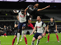Football - 2020 / 2021 EFL Carabao League Cup - Semi-Final - Tottenham Hotspur vs Brentford - Tottenham Hotspur Stadium<br /> <br /> Pinnock of Brentford jumps with Moussa Sissoko of Spurs<br /> <br /> COLORSPORT/ANDREW COWIEFootball - 2020 / 2021 EFL Carabao League Cup - Semi-Final - Tottenham Hotspur vs Brentford - Tottenham Hotspur Stadium<br /> <br /> Pinnock of Brentford jumps with Moussa Sissoko of Spurs<br /> <br /> COLORSPORT/ANDREW COWIE