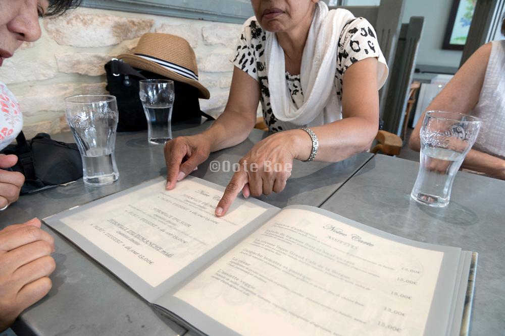 choosing from a restaurant menu