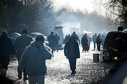 © Licensed to London News Pictures. 23/01/2016. Dunkirk, France. Refugees walk through mud at the migrant camp in Dunkirk, northern France where Leader of the Labour Party JEREMY CORBYN is due to visits today (Sat). Thousands of migrants and refugees at living in temporary accommodation as they attempt to reach the UK. Photo credit: Ben Cawthra/LNP