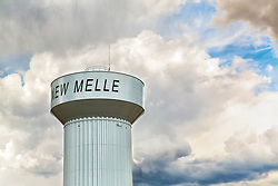 Puffy Blue Clouds on blue skies frame the New Melle Water Tower