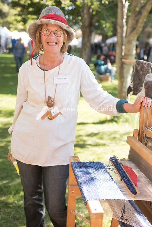Doris Harvest standing by her Loom at Fiber Art Creations booth during the Thousand Springs Art Festival at Ritter Island near Hagerman, Idaho. MR