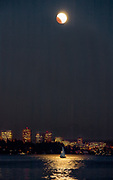 End of total lunar eclipse, Lake Washington and city of Bellevue.