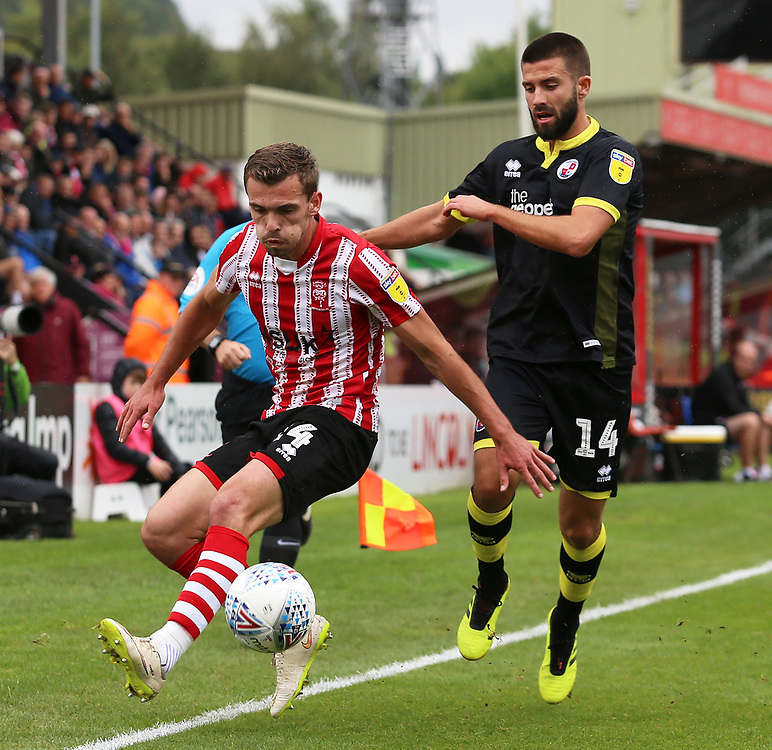 Lincoln City's Harry Toffolo is chased down by Crawley Town's George Francomb<br /> <br /> Photographer David Shipman/CameraSport<br /> <br /> The EFL Sky Bet League Two - Lincoln City v Crawley Town - Saturday September 8th 2018 - Sincil Bank - Lincoln<br /> <br /> World Copyright © 2018 CameraSport. All rights reserved. 43 Linden Ave. Countesthorpe. Leicester. England. LE8 5PG - Tel: +44 (0) 116 277 4147 - admin@camerasport.com - www.camerasport.com