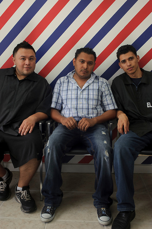 (left to right) Christian Molina from Ecuador, Pablo Galindo from El Salvador and Elmer Hernandez from El Salvador pose for the camera at the Barber Shop where they work located in Brentwood. (July. 14, 2012)