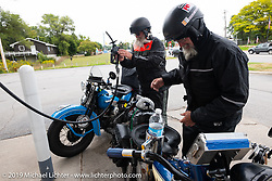 John Bartman (L) and Bill Page stop for gas during the Cross Country Chase motorcycle endurance run from Sault Sainte Marie, MI to Key West, FL. (for vintage bikes from 1930-1948). Stage 1 from Sault Sainte Marie to Ludington, MI USA. Friday, September 6, 2019. Photography ©2019 Michael Lichter.