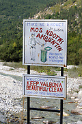 Keep Valbona Beautiful and Clean sign, 'Defile not the environment', in the valley below  The Accursed Mountains, Prokletije, Bjeshkët e Namuna, which have been rebranded as  Blessed Mountains Bjeshket e Bekura.  Valbona, Albania. 05Sep15