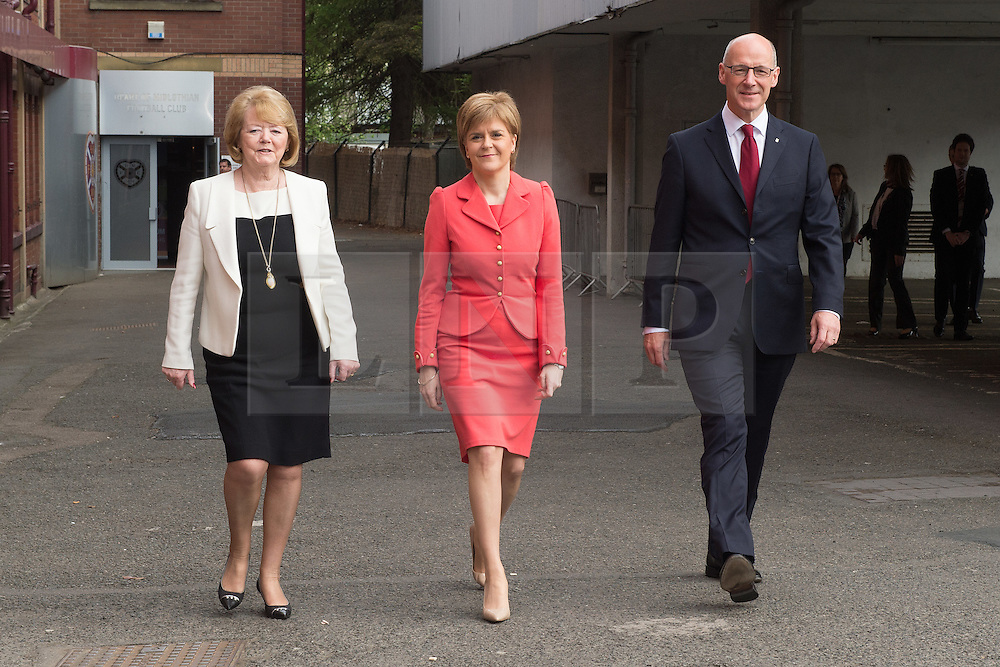 © Licensed to London News Pictures. 26/05/2015. L to R Heart of Midlothian Football Club Chairwoman and Chief Executive Ann Budge,  First Minister Nicola Sturgeon and  Deputy First Minister John Swinney during a visit to winners of the Scottish Championship, Heart of Midlothian Football Club where Nicola Sturgeon delivered her first first economic speech since the general election. Photo credit: Max Bryan/LNP
