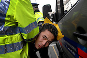 UNITED KINGDOM - LONDON A man is arrested by a police officer as protesters at the Chinese Embassy attempt to attack the Chinese Premier Wen Jai Boa, as his car arrives there as part of a visit to London 01 FEB 2009. STEPHEN SIMPSON