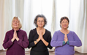 Senior women doing yoga