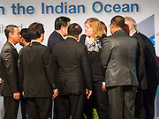 "29 MAY 2015 - BANGKOK, THAILAND: Participants in the ""Special Meeting on Irregular Migration in the Indian Ocean"" gather around ANNE CLAIRE RICHARD, the US Assistant Secretary of State for Population, Refugees, and Migration Affairs, at the opening of the meeting. Thailand organized and hosted the meeting at the Anantara Siam Hotel in Bangkok. The meeting brought together representatives from the 5 countries impacted by the boat people exodus: Thailand, Malaysia and Indonesia, which have all received boat people, and Myanmar (Burma) and Bangladesh, where they are coming from. Non-governmental organizations, like the International Organization for Migration (IOM) and UN High Commissioner for Refugees (UNHCR) as well as countries responding to the crisis, like the United States, also attended the meeting. A total of 22 organizations attended the one day conference.      PHOTO BY JACK KURTZ"