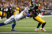 Pittsburgh Steelers wide receiver Antonio Brown (84) powers through Dallas Cowboys cornerback Mike Jenkins (21) tackle attempt at the end zone for a touchdown at Cowboys Stadium in Arlington, Texas, on December 16, 2012.  (Stan Olszewski/The Dallas Morning News)