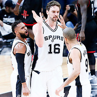 03 May 2017: San Antonio Spurs center Pau Gasol (16) celebrates with San Antonio Spurs guard Patty Mills (8) and San Antonio Spurs guard Tony Parker (9) during the San Antonio Spurs 121-96 victory over the Houston Rockets, in game 2 of the Western Conference Semi Finals, at the AT&T Center, San Antonio, Texas, USA.