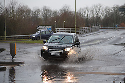 © Licensed to London News Pictures. 26/01/2014. M3, Basingstoke, Hampshire, UK. A Land Rover 4x4 driving through flood water in Basingstoke today (26/01/2014). Wet and windy weather has engulfed much of the UK over the weekend. Photo credit : Rob Arnold/LNP