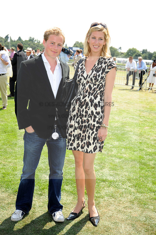 GUY PELLY and SUSANNA WARREN at the Cartier International Polo at Guards Polo Club, Windsor Great Park on 27th July 2008.<br /> <br /> NON EXCLUSIVE - WORLD RIGHTS
