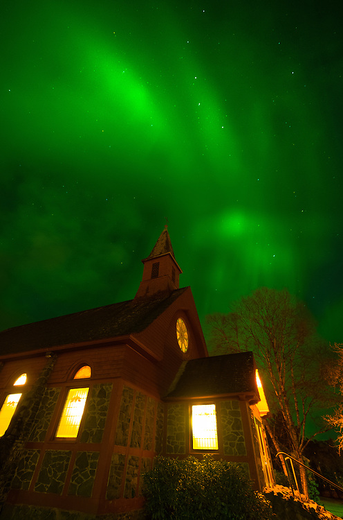 Aurora above Saint Peters church in Sitka Alaska