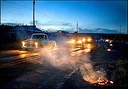As the luminarias continue to burn, Robert Garcia cruises up and down Highway 337 in Chilili driving his yellow 1957 Chevy truck just after sunset...