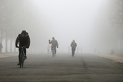 © Licensed to London News Pictures. 28/12/2020. London, UK. People in dense freezing fog in Finsbury Park, north London as many parts of the UK wakes to further freezing temperatures. Photo credit: Dinendra Haria/LNP