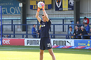 AFC Wimbledon goalkeeper Nicola Tzanev (25) warming up during the EFL Sky Bet League 1 match between AFC Wimbledon and Oxford United at the Cherry Red Records Stadium, Kingston, England on 29 September 2018.